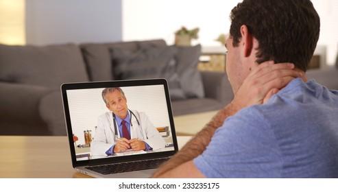 Man using laptop to talk to doctor