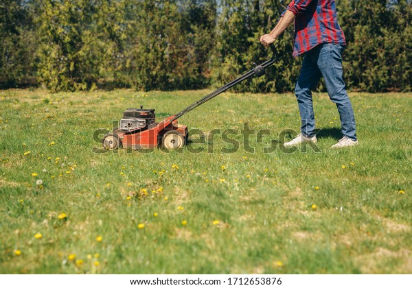 man using lawn mower outdoor