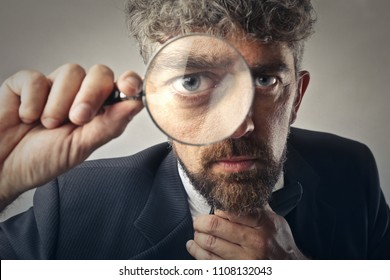 Man using a magnifier