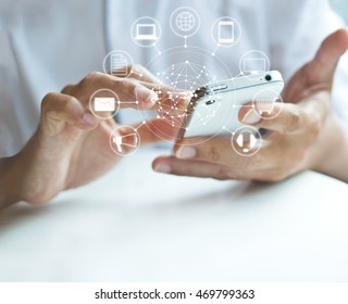Man using mobile payments, holding circle global and icon customer network connection, Omni Channel, blank text