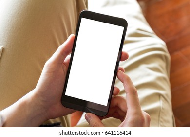 man using mobile phone with blank screen indoor, close up - clipping path inside