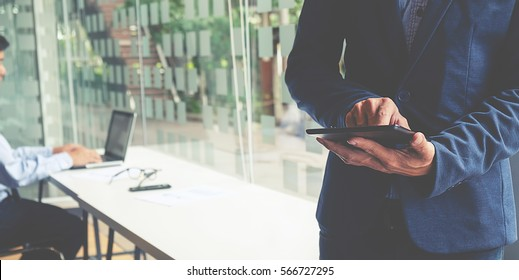 Man using mobile phone with hand, touch screen. Project Manager Researching Process. Business Team Work Startup modern Office.