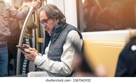 Man using mobile phone in the metro train