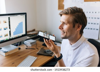 Man using mobile phone. Social media use at work. Work from home Clubhouse the voice-only social media app. Smiling male talking on the phone social platform built around drop-in audio chat