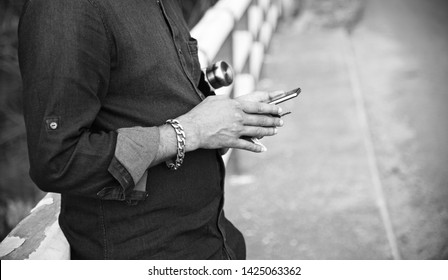 Man using a mobile phone standing in a place unique photo