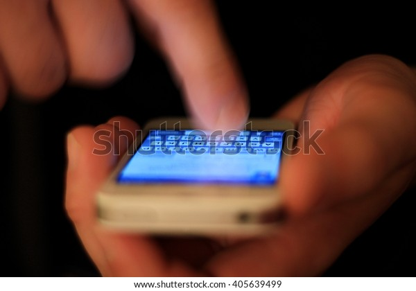 Man using mobile smart phone and closeup of the display, he taps information or a message in the phone