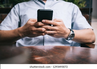 Man using mobile smartphone. Close up hands. Business, lawer, cell company advertise. Perspective image