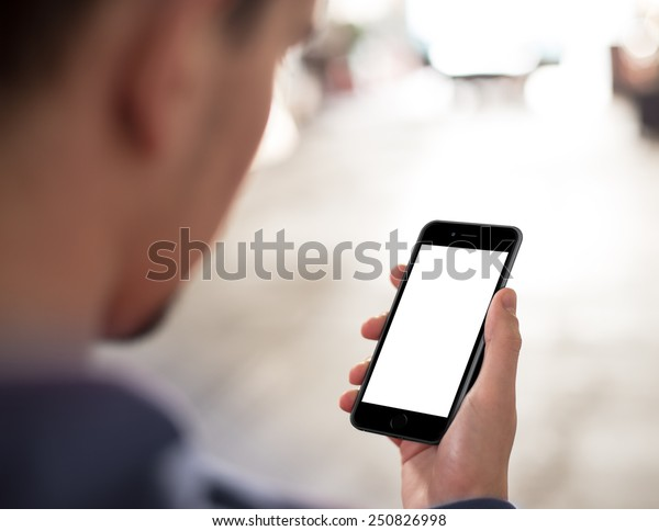 Man using mobile smartphone. Shot with third-person view, blank screen.