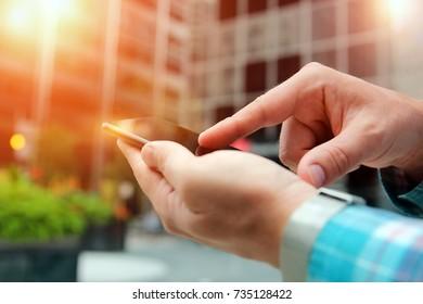 man using a   modern mobile phone outside