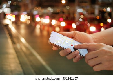 man using navigation app on the smartphone on street at night, all on mobile screen are designed up