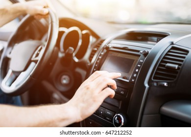 Man using navigation system while driving car
