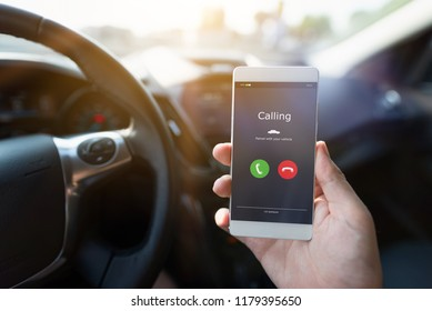 Man using phone calling system in car. Hand-free safety driving.