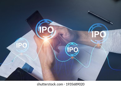Man using phone. Hands typing smartphone. Double exposure with ipo hologram. Close up. Financial graph and analysis concept. Investment.