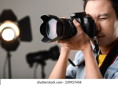 Man using professional camera in the studio