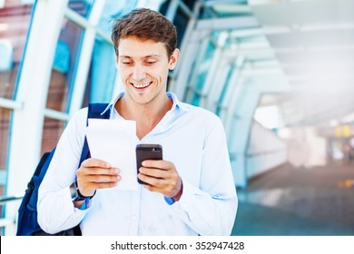 man using smart phone to book airplane tickets or do online chec kin