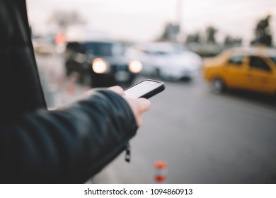 Man using smart phone at traffic
