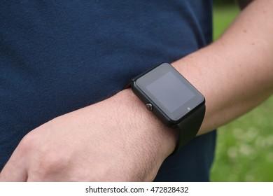 Man using smart watch outdoors