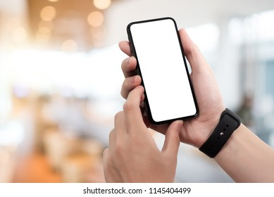 Man using smartphone at abstract blurred street night. Blank screen for graphics display montage.