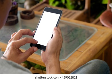 man using smartphone. blank screen of mobile phone in man's hands.