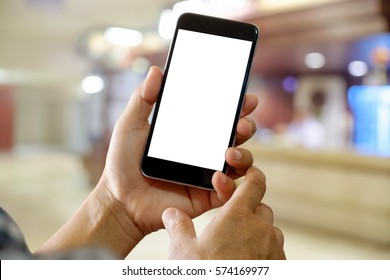 Man using Smartphone with Blurred Hospital background