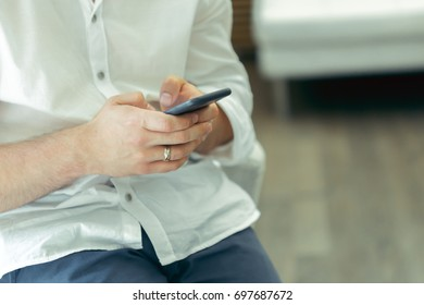 Man using smartphone at coffee shop