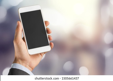 Man using a smartphone on bokeh background