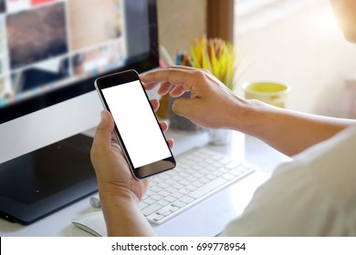 Man using smartphone on White office desk table.