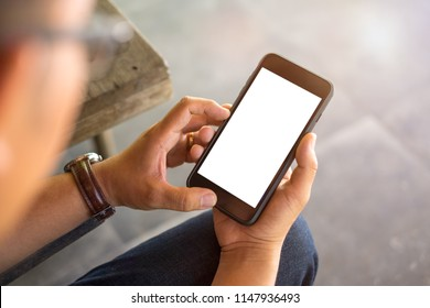 Man using smartphone in shopping mall space background and copy space. Blank screen for graphics display montage.
