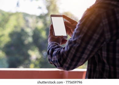 Man using smartphone with white screen, blank screen, blurred background