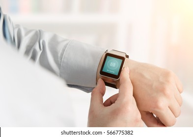 Man using smartwatch with e-mail notifier. smartwatch hand device notify computer internet message e-mail concept