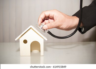 Man using  stethoscope with house show home inspection or check the financial condition for Buying or living concept.