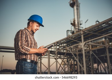 Man using tablet at natural gas factory