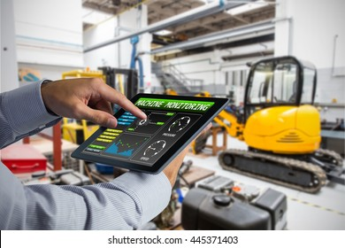 Man using tablet pc against industrial equipments in factory