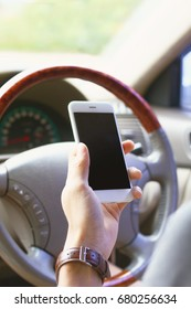 man using white smart phone blank screen in car on the way