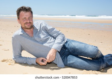 a man in vacation on sand of ocean