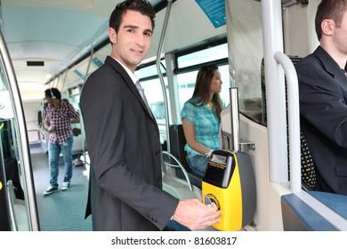 Man validating bus ticket
