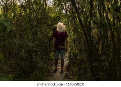 Man vaping in the woods