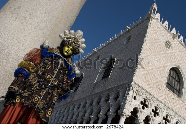 A man in Venetian costume standing in St. Mark's Square, Venice