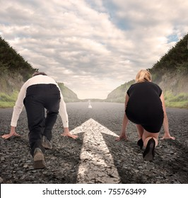 man versus woman on a road with arrow painted on it