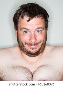 man with a very large set of man boobs