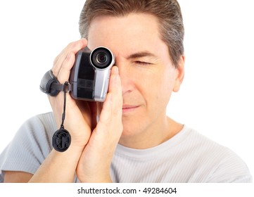 Man with video camera. Isolated over white background