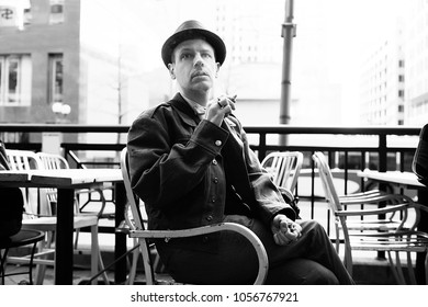 Man in Vintage Army Jacket Smoking Cigarette