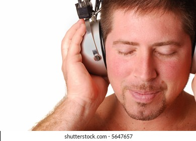 Man with vintage headphones over white background