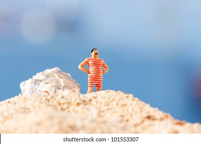 Man in vintage swimming costume standing on the beach