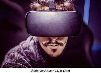 man in virtual glasses is watching a movie in 5d