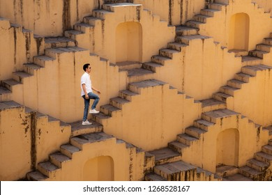 Man visit the ancient Indian step well in Jaipur, India.