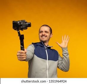 Man vlogger or blogger or videographer filming hisself on camera