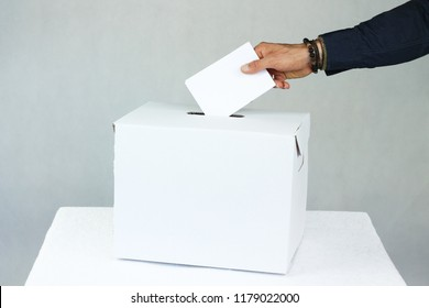 man voting in elections