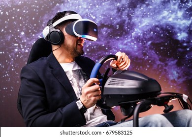 Man with VR glasses of virtual reality. Young boy in virtual augmented reality helmet. VR headset. Future technology concept.