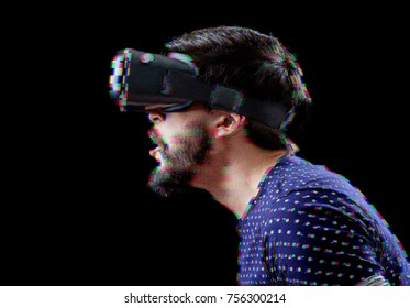 Man with VR goggles exploring virtual reality. Digital glitch effects added